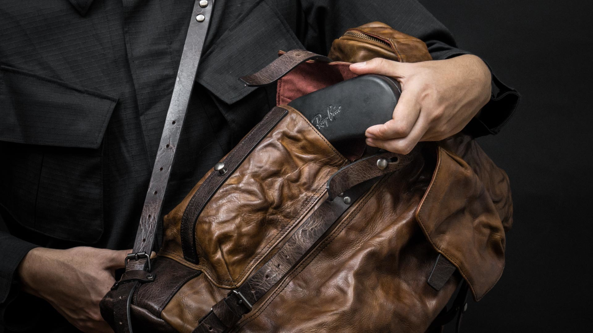 Access sunglasses case in side pocket.
