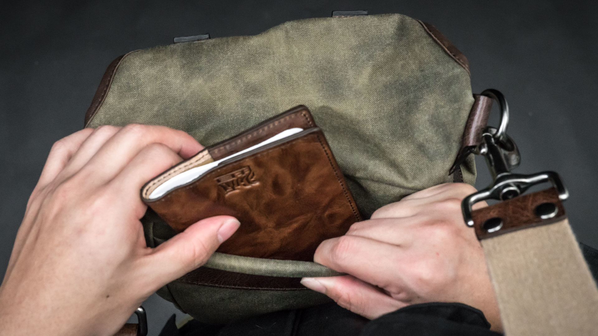 Fitting notebook into back pocket.