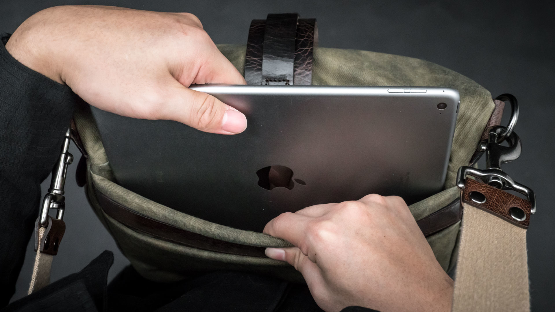 Fitting iPad into back pocket.