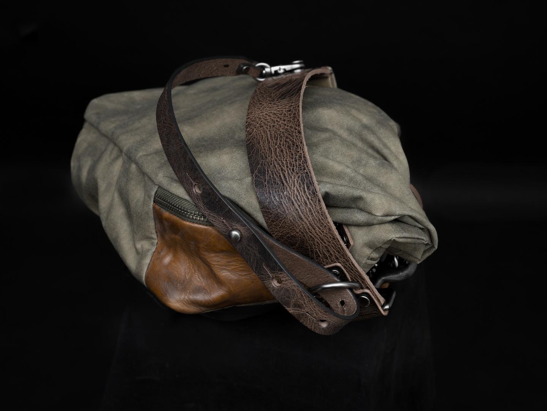 Leather shoulder straps closeup.