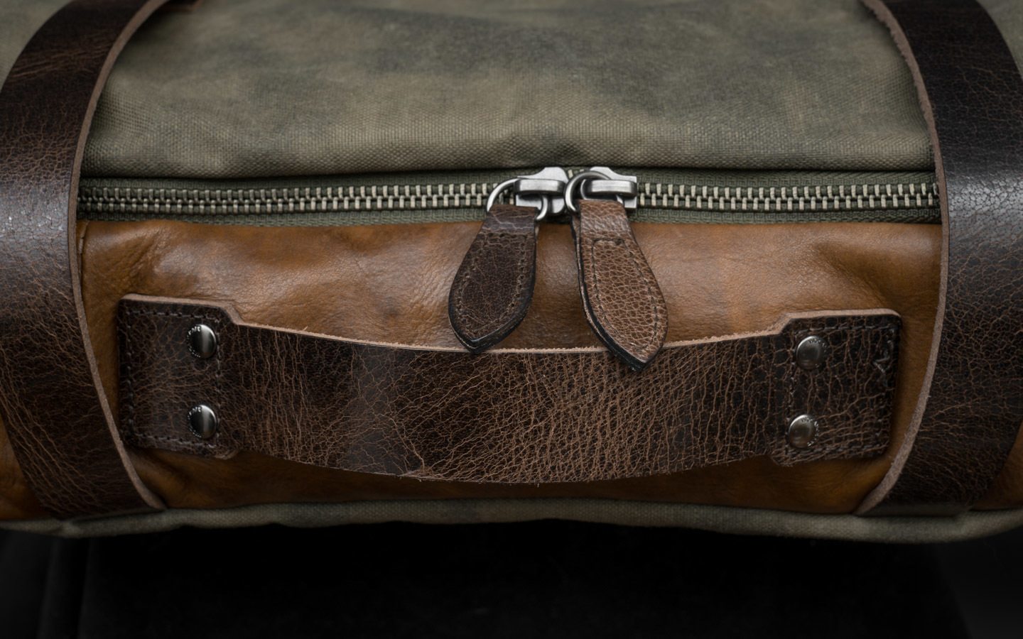 Battle-distressed cowhide leather.