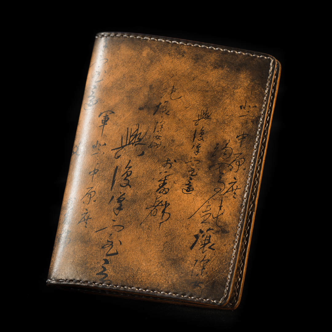 """PATH OF WAR"" CALLIGRAPHY LEATHER PASSPORT SLEEVE"